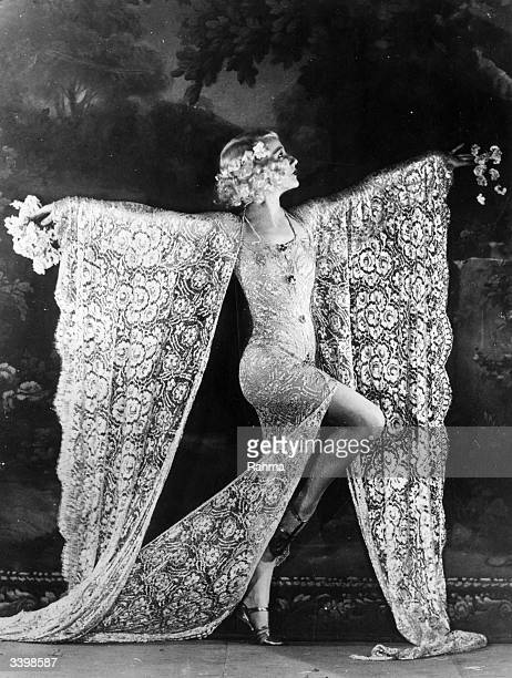 Dancer Edmonde Guydens dancing at the Moulin Rouge nightclub in Paris in a costume made of lace