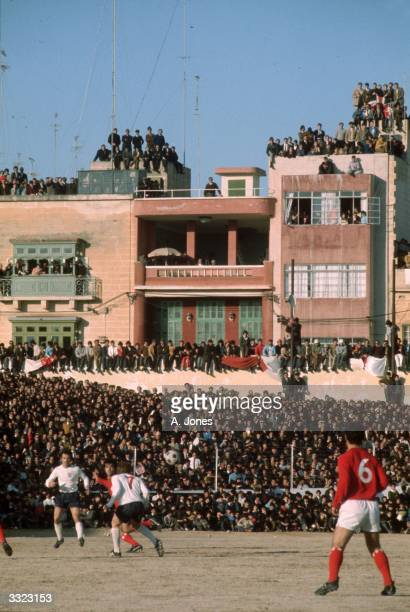Crowds of supporters watching the European Championship qualifying match between Malta and England from the balconies and roofs of buildings near the...