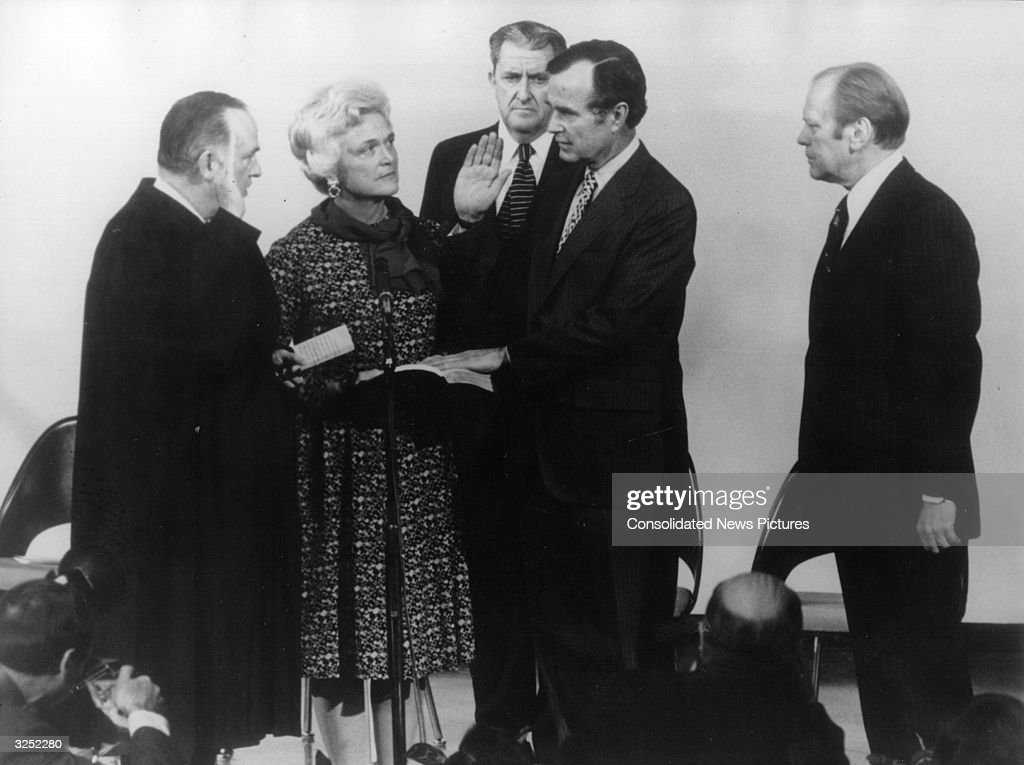 American politician George Bush later the 41st President of the United States of America takes his oath of office as director of the CIA with his...