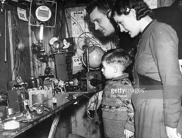 Mr Stanley Hardman an amateur radio operator at his transmitting station with his family