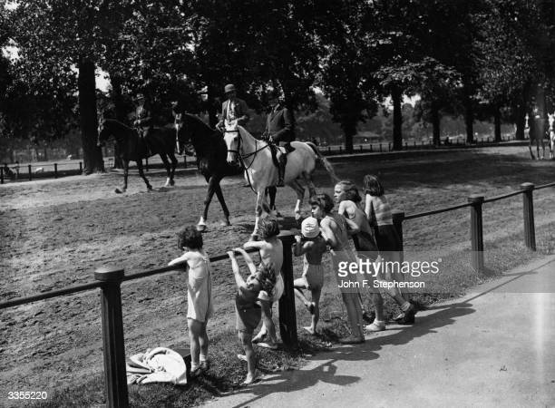 These children were the envy of riders in Rotten Row Hyde Park in London during the morning's terrific heat