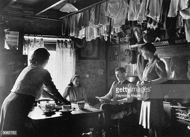 The Jones family of Cymgiedd south Wales having tea in their homely kitchen with clothes airing on a pulley They are taking part in a film by the...