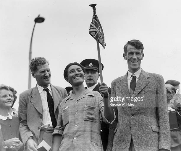 From left to right Colonel John Hunt Tenzing Norgay and Edmund Hillary make a jubilant return to Britain after becoming the first men to scale Mount...