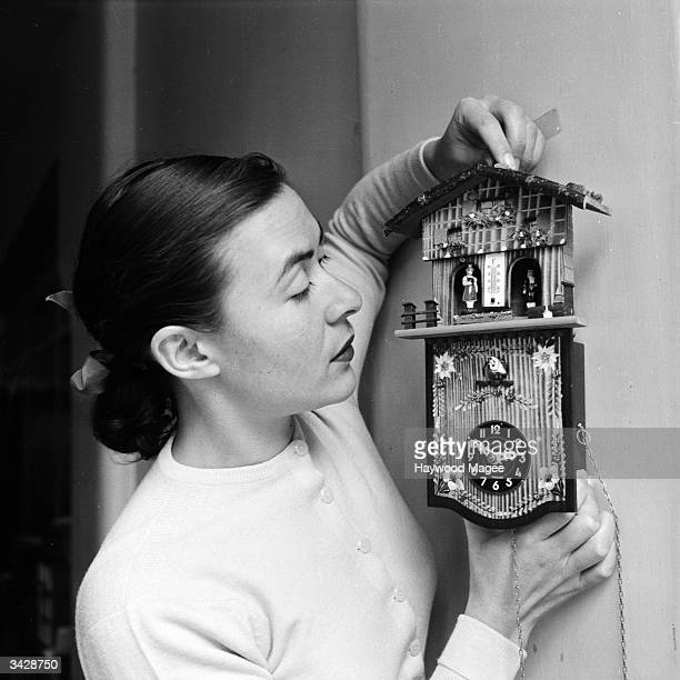 A woman tries out an oldfashioned weather clock a quaint means of finding out the weather forecast Original Publication Picture Post 7200 One Week In...
