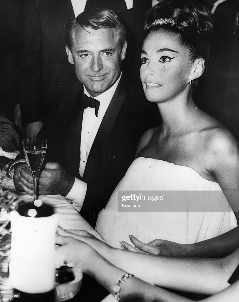 Cary Grant and Pier Angeli at a Berlin screen ball to mark opening of 10th International Screen Festival
