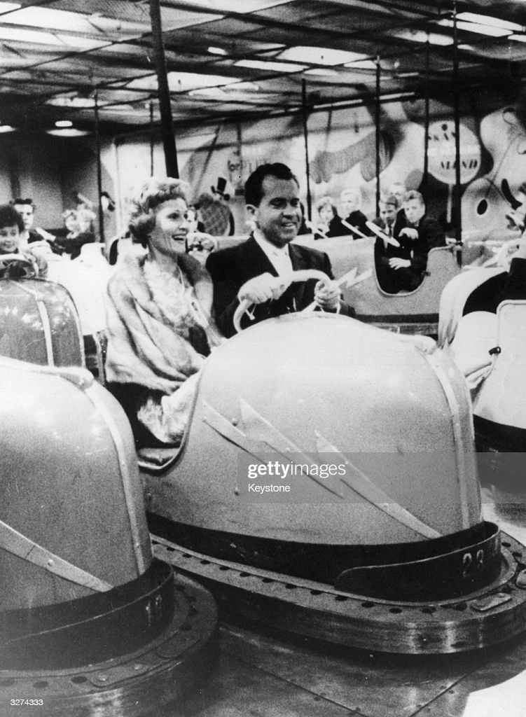 American politician, former Vice-President and future President Richard Nixon enjoying the 'dodgem' cars in the Tivoli Gardens in Copenhagen with his wife Pat.