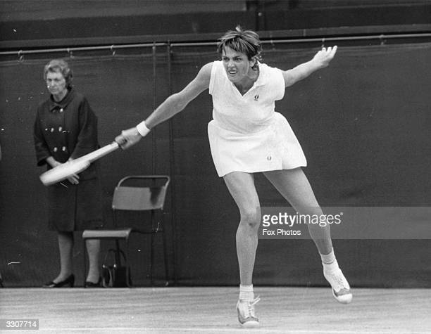 Australian tennis player Margaret Court hits a powerful backhand during the women's singles final against Billie Jean King at Wimbledon which Court...