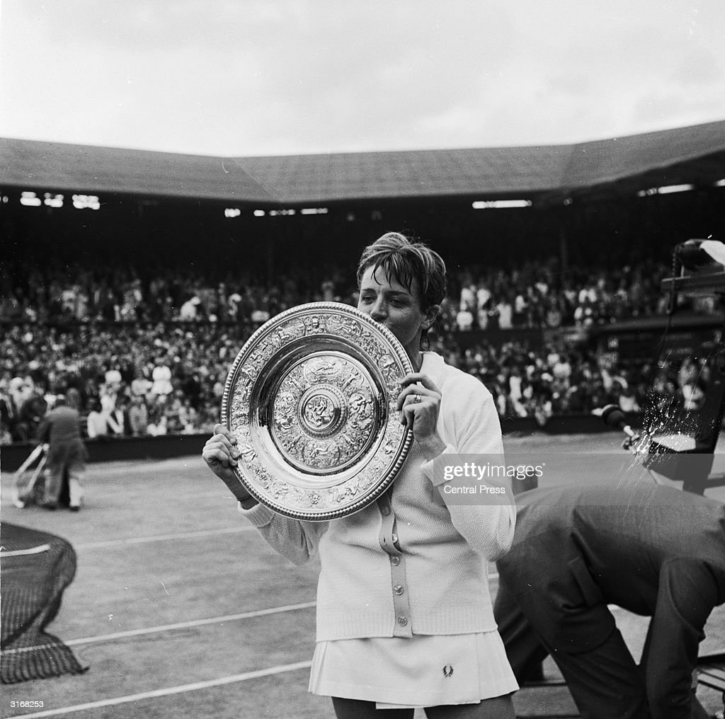 Australian tennis player <a gi-track='captionPersonalityLinkClicked' href=/galleries/search?phrase=Margaret+Court&family=editorial&specificpeople=226911 ng-click='$event.stopPropagation()'>Margaret Court</a> with the Ladies Singles title trophy which she won by beating her old rival Billie-Jean King in straight sets.