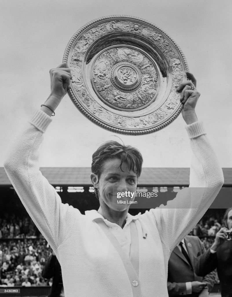 <a gi-track='captionPersonalityLinkClicked' href=/galleries/search?phrase=Margaret+Court&family=editorial&specificpeople=226911 ng-click='$event.stopPropagation()'>Margaret Court</a> (nee Margaret Smith) holds aloft the trophy after beating American Billie Jean King in the finals of the Women's Singles title at Wimbledon. She won 14 - 12, 11 - 9, the longest women's final to date and was a grand slam winner in this year. She won Wimbledon three times, the Australian singles eleven times and the USA title seven times.