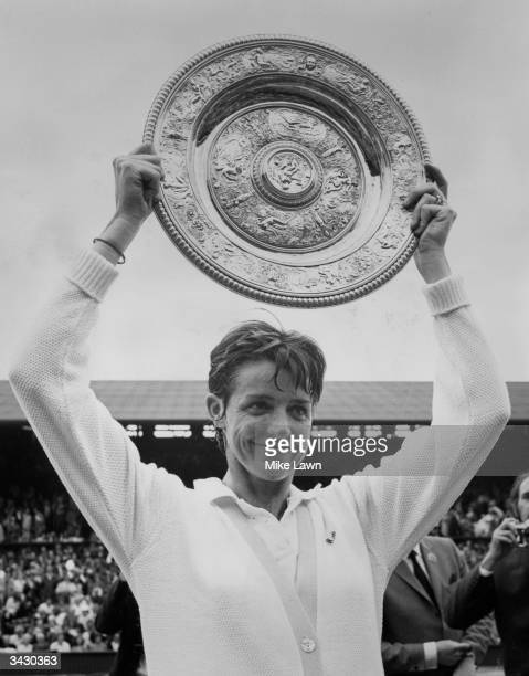 Margaret Court holds aloft the trophy after beating American Billie Jean King in the finals of the Women's Singles title at Wimbledon She won 14 12...