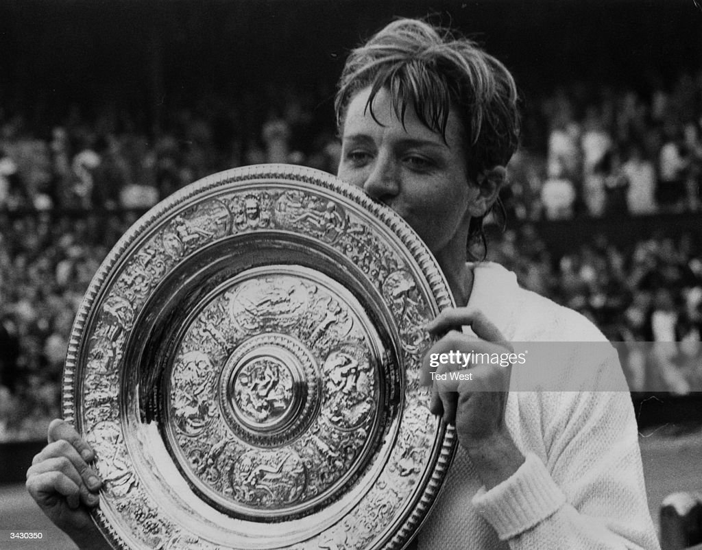 Margaret Court kisses the winner's plate after she beat Billie Jean King to win the Ladies' Singles Championship at Wimbledon 14 12 11 9