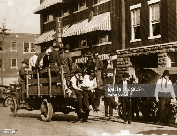 Martial law in Tulsa Oklahoma after the race riots Injured and wounded prisoners are being taken to hospital by National guardsmen