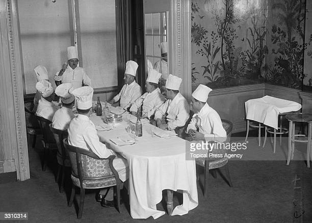 Chefs from the Savoy Hotel sitting down to dinner