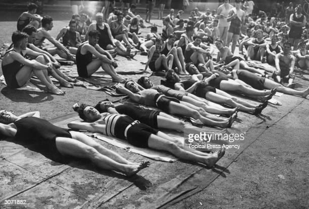 Londoners in bathing suits taking advantage of a heat wave at Hyde Park lido