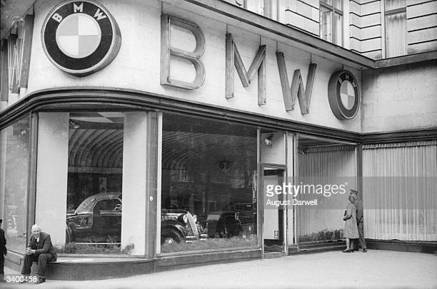New motor cars in the window of a BMW showroom in Berlin Original Publication Picture Post 152 Berlin On A Sunny Day pub 1939