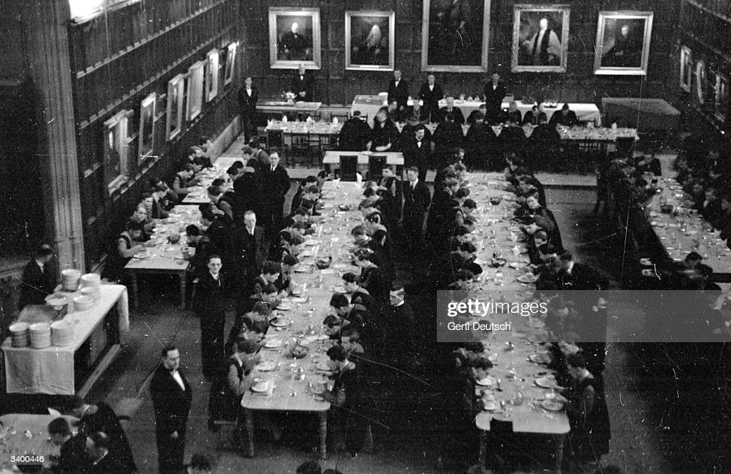 Students At Cambridge University Dining In The Hall Of Their College Pict