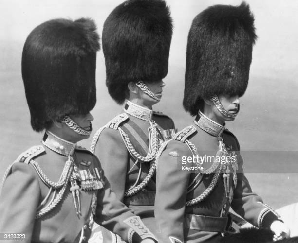 Prince Philip Duke of Edinburgh Charles Prince of Wales and Edward Duke of Kent wearing Guards' uniforms and bearskins at a Trooping of the Colour...