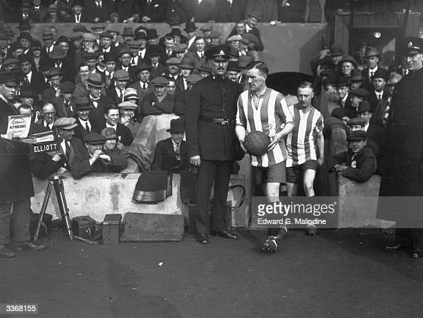 Stoke City captain McGrory leads his team out for a sixth round FA cup tie against Arsenal at Highbury
