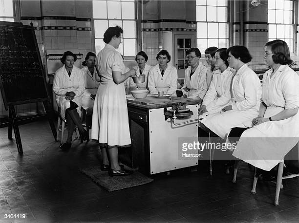 Girls in the lower fifth form of the girl's School at Christ's Hospital Hertford are given a home economics lesson