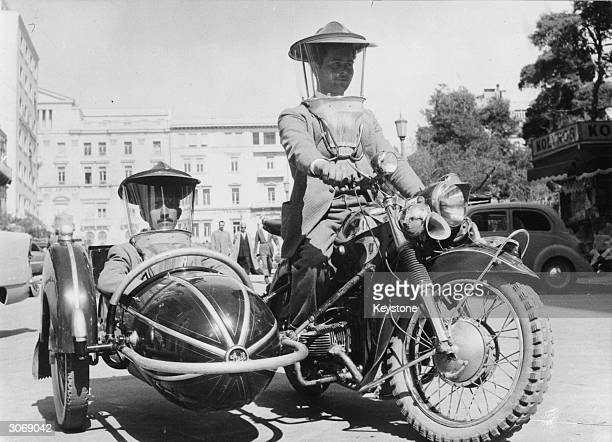 A motorcyclist and his sidecar passenger try out the new plastic headgear marketed by a Greek company to protect them from the wind rain and cold...