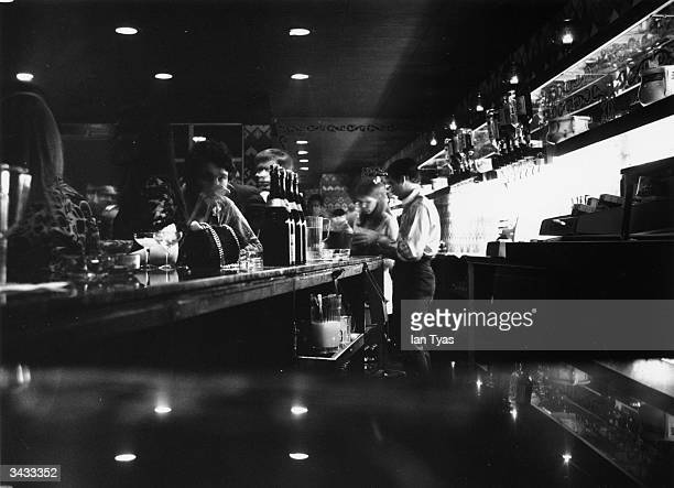 People drinking at the bar of The Speakeasy nightclub near Oxford Circus London