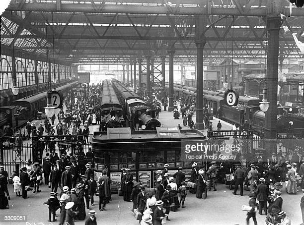 Crowds of Londoners at Waterloo Station leaving for the seaside