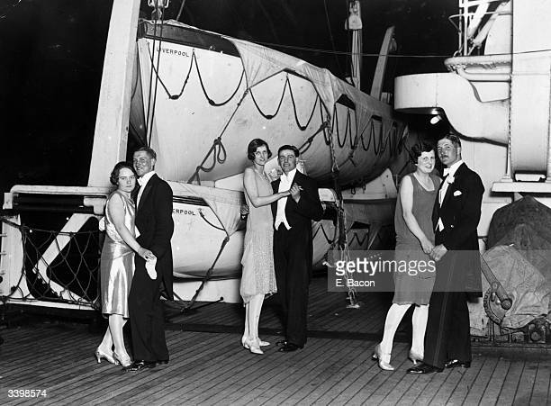 A group of guests dancing on board the White Star Liner 'Majestic' at Southampton Docks during the Hampshire County Ball in aid of the Royal South...