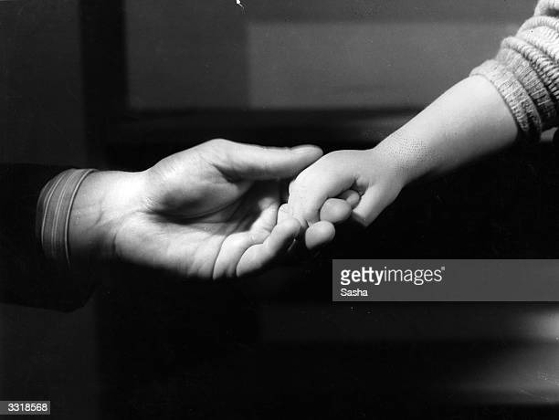Actors holding hands during a production of 'Michael and Mary' at St James' Theatre London The story is told by hands