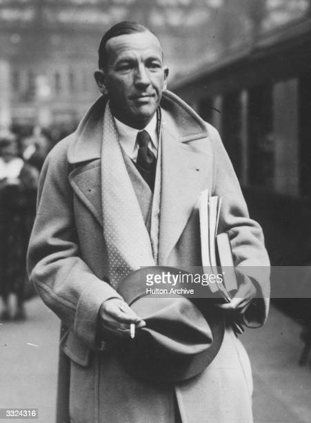 British playwright actor and composer Noel Coward at Waterloo London on his return from America