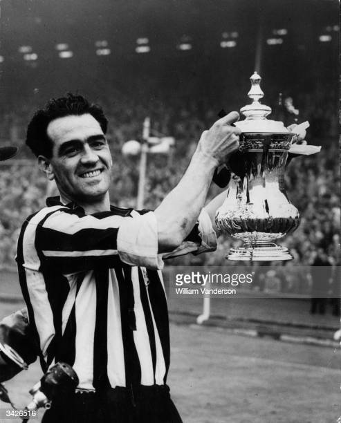 Newcastle captain Joe Harvey with the FA Cup after his team beat Arsenal 10 in the final at Wembley