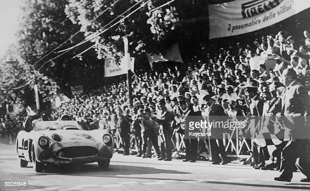 British racing driver Stirling Moss on his way to winning the Italian Mille Miglia Race setting a new record