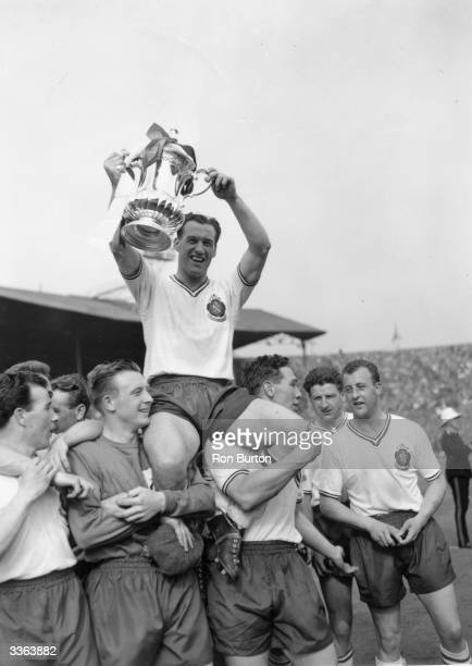 Bolton Wanderers captain Nat Lofthouse sits on the shoulders of his team mates as he lifts the FA Cup trophy after their 20 victory over Manchester...