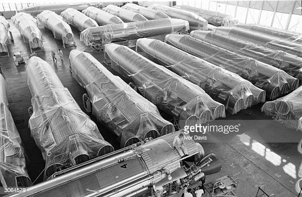 Obsolete Atlas ICBMs wrapped and stacked side by side at Norton Air base California