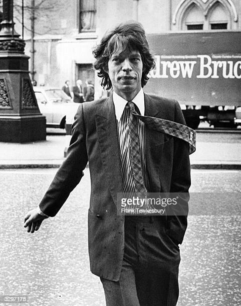 Mick Jagger singer and songwriter with British rock group the Rolling Stones in London to appear in court over his divorce settlement