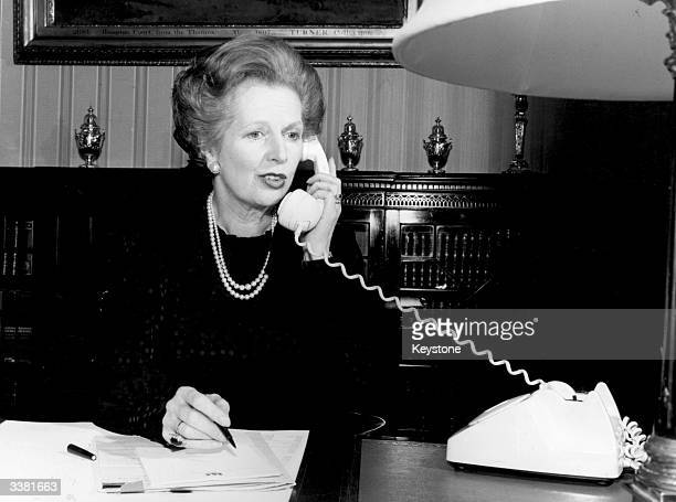 British stateswoman Margaret Thatcher telephoning fellow prime minister Indira Gandhi to mark the Golden Jubilee of the opening of direct public...