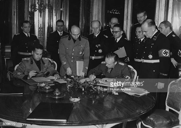 Foreign ministers Count Galeazzo Ciano of Italy and Joachim von Ribbentrop of Germany signing the arbitration award on the CzechHungary frontier...