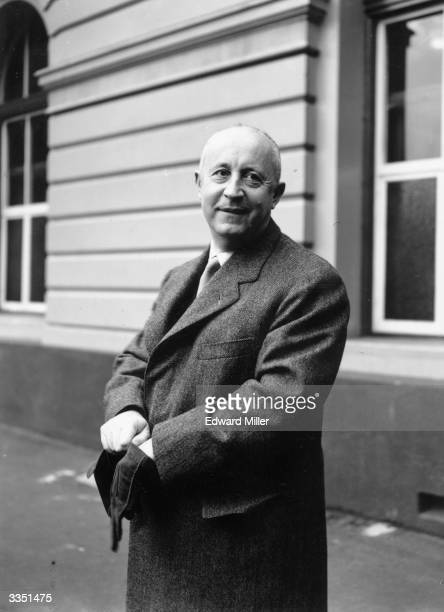 French fashion designer Christian Dior arrives from Paris at Victoria London to attend his fashion parade which is being held at Blenheim Palace in...