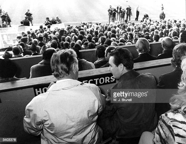 Brian Clough manager of Brighton And Hove Albion Football Club and his assistant Peter Taylor watch their team play York City from the stands