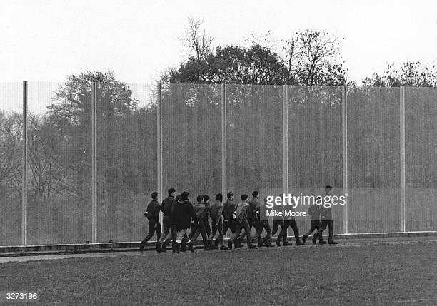Boys exercising in the Junior Detention centre at Send near Woking Surrey