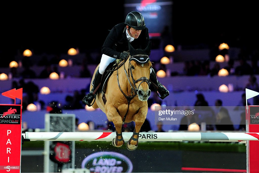 3rd place finisher Gerco Schroder from Netherlands rides Glock's Prince de Vaux at Le Figaro Prize as part of the Gucci Paris Masters 2014 on December 6, 2014 in Villepinte, France.