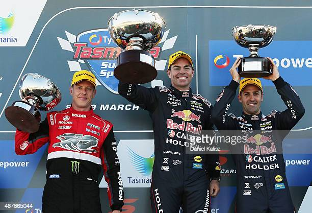 3rd place James Courtney driver of the Holden Racing Team Holden VF Commodore 1st place Craig Lowndes driver of the Red Bull Racing Holden VF...