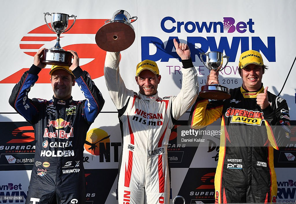 3rd place Jamie Whincup driver of the Red Bull Racing Australia Holden Commodore VF 1st place Michael Caruso driver of the Nissan Motorsport Nissan...