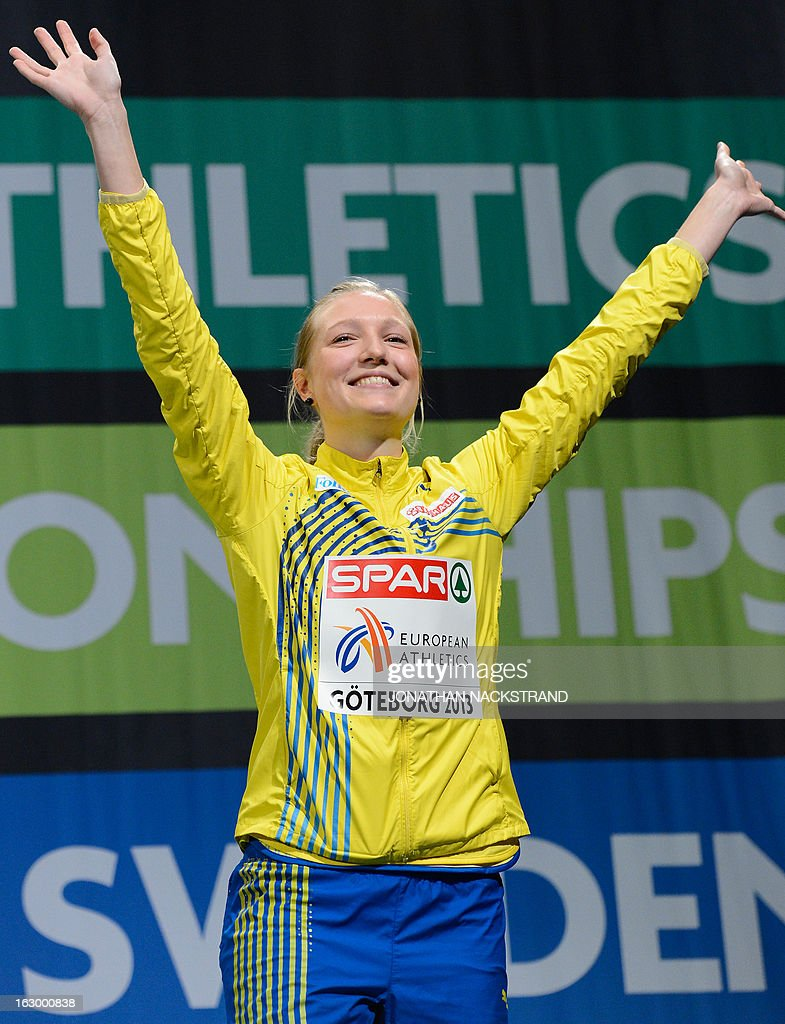 3rd place Sweden's Moa Hjelmer celebrates after the women's 400m final on the podium at the European Indoor athletics Championships in Gothenburg, Sweden, on March 3, 2013.