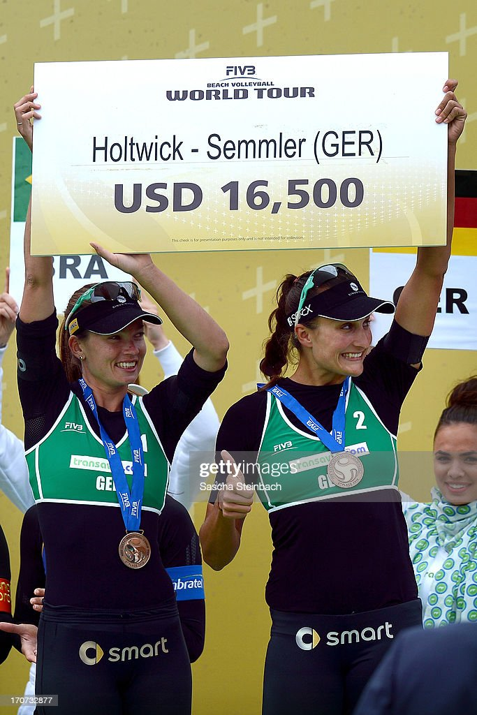 3rd place winners Katrin Holtwick (L) and Ilka Semmler (R) of Germany celebrate with their bronze medals during the FIVB Grand Slam final match day at The Hague Beach Stadium on June 16, 2013 in The Hague, Netherlands.