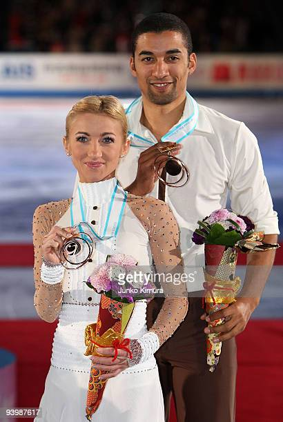 3rd placed Aliona Savchenko and Robin Szolkowy of Germany pose for photographs after competing in the Pairs Free Skating on the day three of ISU...