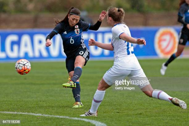 Rumi Utsugi of Japan Women challenges Elin Metta Jensen of Iceland Women and scores during the match between Japan v Iceland Women's Algarve Cup on...
