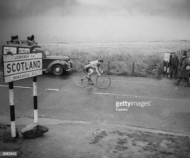 British cyclist Dave Bedwell crossing the English Scottish border in the Daily Express 14 day cycle tour of Britain
