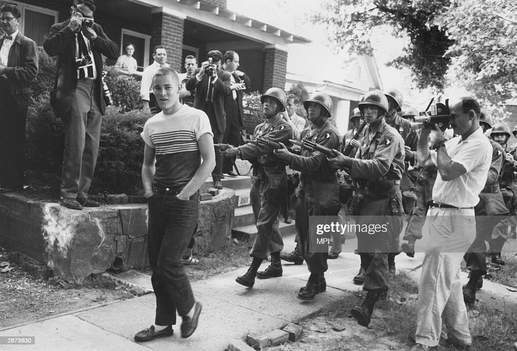 Federal troops confront a racist student from Little Rock Central High School, Arkansas. It took 10,000 of the National Guard to convince white students that blacks had the right to enter the school.