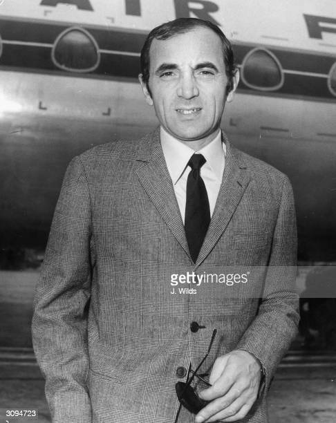 Singer and actor Charles Aznavour arriving at London Airport to give a concert in the Albert Hall