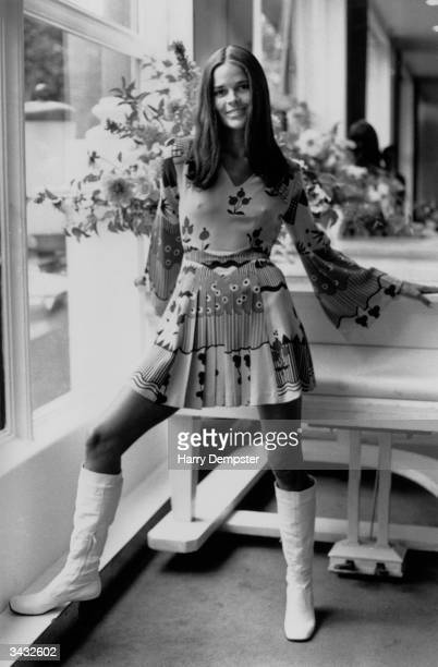 Film star Ali MacGraw in a multipatterned dress by Chelsea designer Ossie Clark